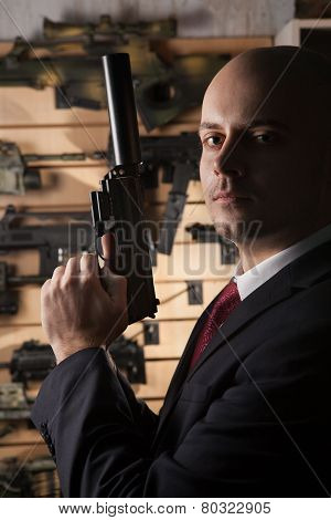Bald Hitman With The Gun