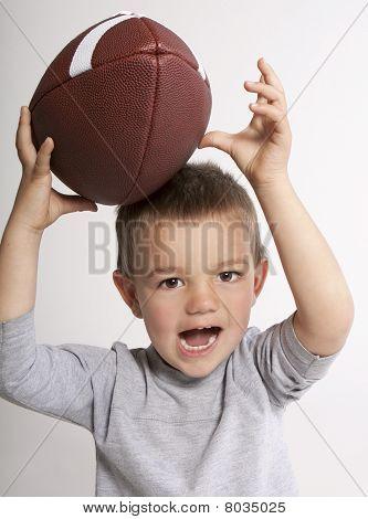 Toddler Catching Football