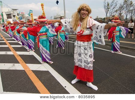 Japanese Man dressed as a woman at a Dance Festival Parade