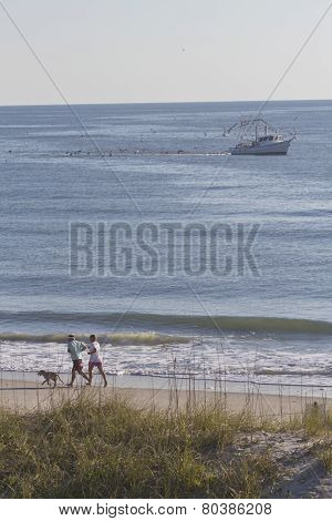 Jogging And Fishing On Beach And Sea