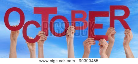 People Hands Holding Red Word October Blue Sky