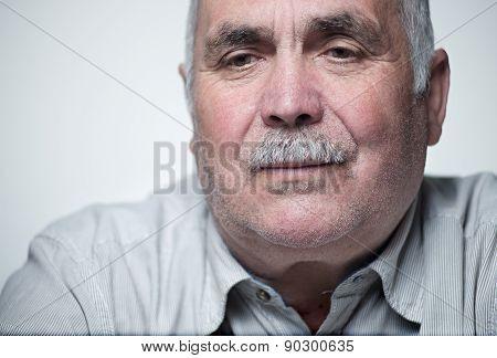 Close-up Portrait Of A Caucasian Senior Man With Mustache