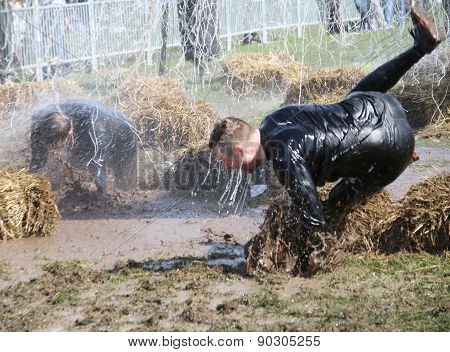 A Man Makes A Spectacular Overturn In The Mud