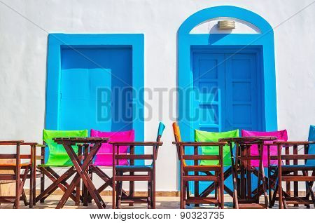 Colorful Greek restaurant table and chairs, Greece