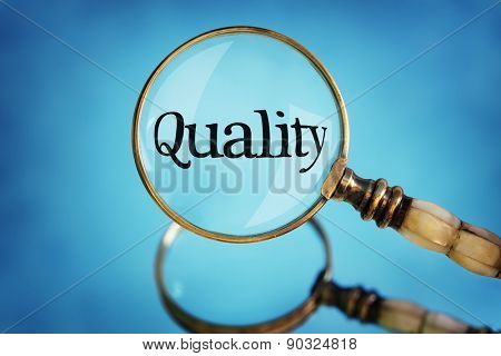 Magnifying glass focus on word quality concept for quality control, customer satisfaction and excellence