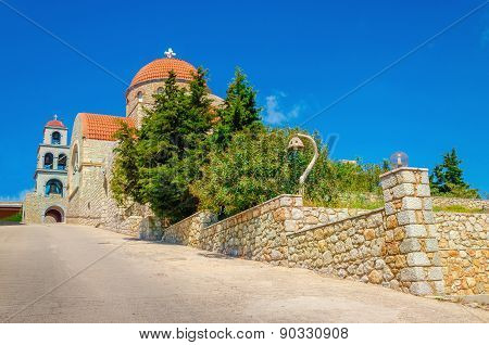 Greek typical church with red roofing, Greece