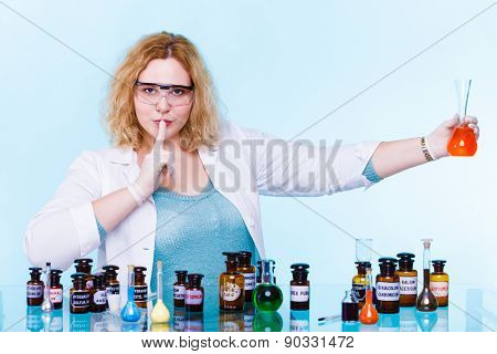Experiment research in progress. Chemist woman or student girlscientific researcher with chemical glassware test flask hand silence sign saying hush be quiet. poster