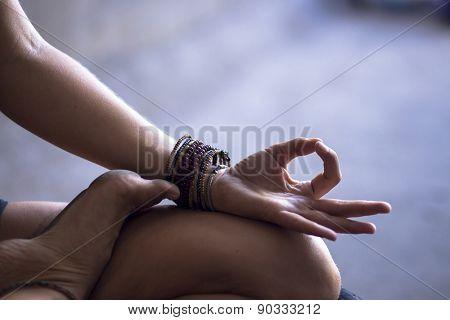 Young woman meditating indoors