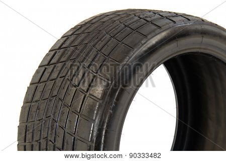 Detail of tubeless radial race tire 27/65-18 isolated on white background