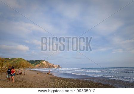Unidentified tourists enjoying a day in the beach of Ayampe, Ecuador