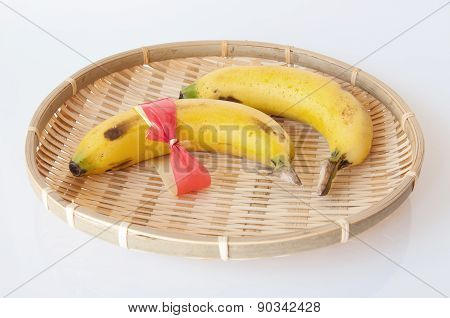 Ripe Yellow Bananas In A Wicker Basket Isolated On White Background