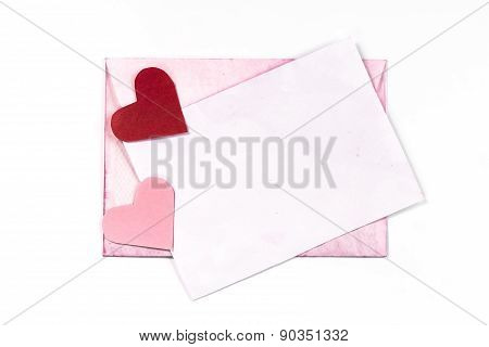 isolated pink vintage envelope with two paper hearts