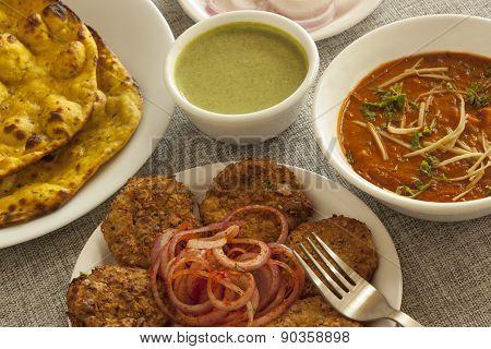 Dahi ka kebab with missi roti and panner adarki