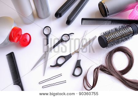 Set Hairdressing Articles On A White Table Top View