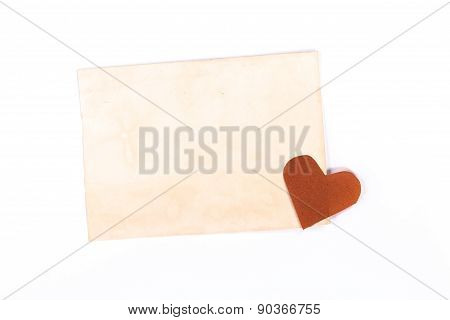 isolated vintage page with yellow paper heart