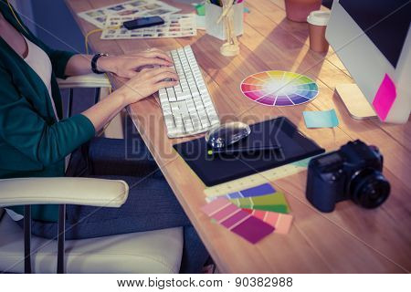 Designer working at her desk in creative office