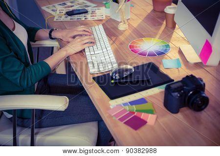 Designer working at her desk in creative office