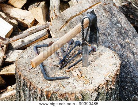 Hew Axe And Forged Hardware On Wooden Block