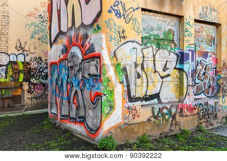 Abandoned Urban Courtyard With Graffiti Patterns