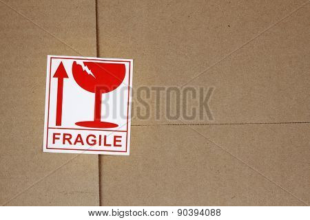 Fragile label on cardboard box poster