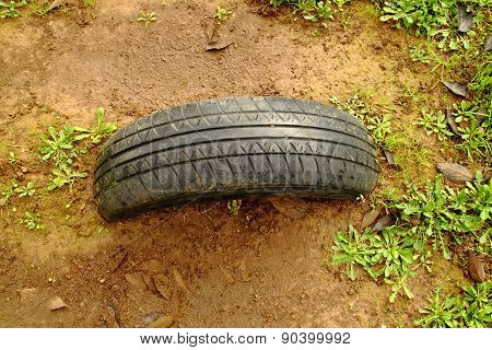 Tire stuck in the ground