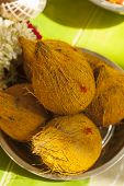 Top View of Coconuts with turmeric on upanayanam ceremony function. poster