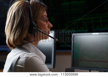 Operator With Headphone In Power Distribution Control Center