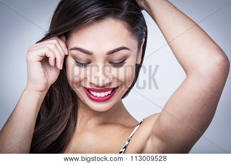 Shy Playful Beauty In Studio Portrait