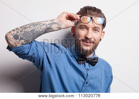 Cheerful young man is expressing positive emotions