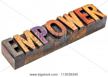 empower word abstract  - an isolated motivational banner in vintage letterpress wood type stained by color inks