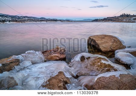 winter dawn over icy shores of Horsetooth Reservoir near Fort Collins in northern Colorado
