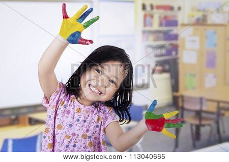 Smiling Girl With Painted Hands