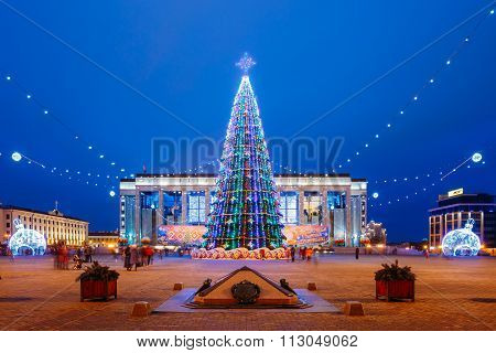 Christmas tree, illuminations and decorations in front of buildi