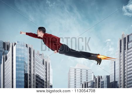 Asian Business Man Flying With Rocket On The Shoes