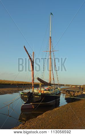 The sailing barge Juno moored at Blakney North Norfolk England.