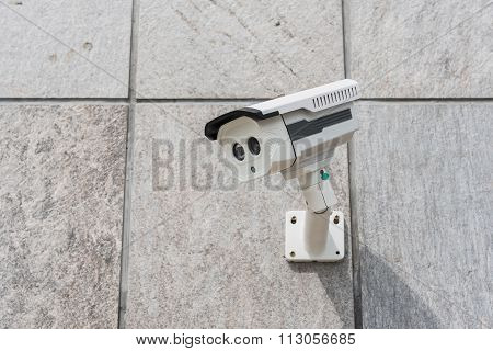 Cctv Security Camera On Stone Wall