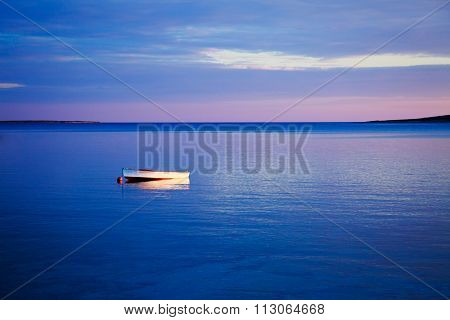Seascape with White Boat in Blue Sea at Sunset