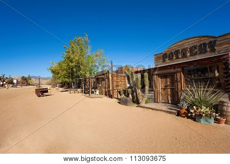 Pioneer town street with pottery store