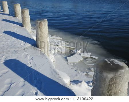 Dockside Posts, Ice, and Shadows