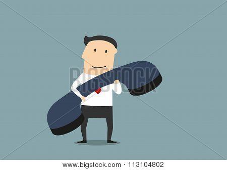 Businessman with large blue handset