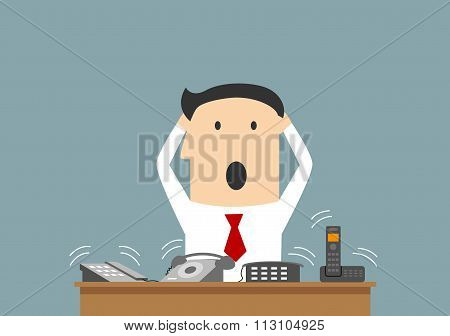Busy businessman and ofice telephone calls