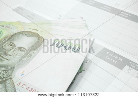 Thai Money Banknote On Record Table Note Book