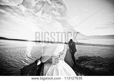 Multiexposition Of Very Sensual And Gorgeus Wedding Couple On The Picturesque Landscapes