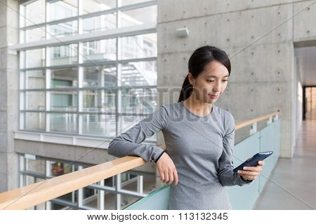 Woman checking something on cellphone at indoor