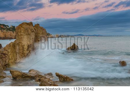 Waves Crashing Against The Rocks. Albufeira Beach Riffes.