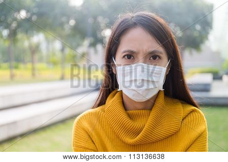 Asian Young Woman wearing the face mask