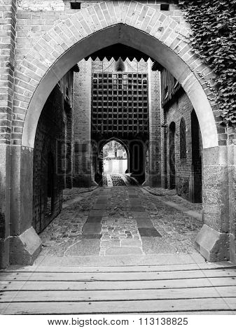 Medieval castle gate with iron bars