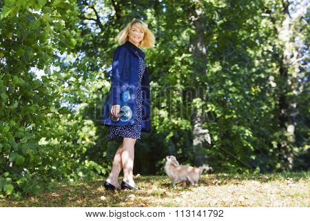 Woman dancing in the park with dog