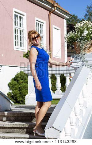 Elegant woman posing on the mason stairs