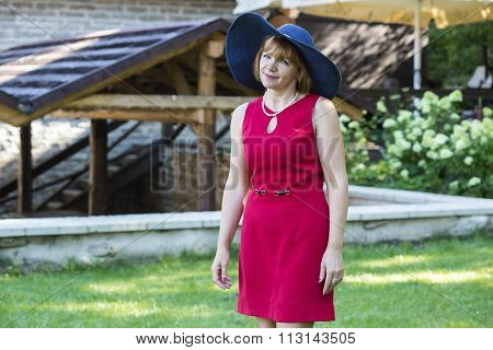 Lady in red wearing blue retro hat